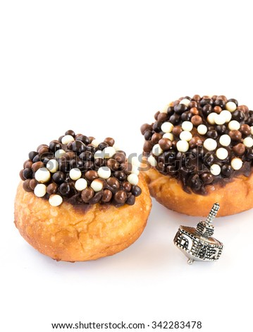 Fresh donuts and  silver dreidel  for Chanukkah Jewish Holiday.  - stock photo