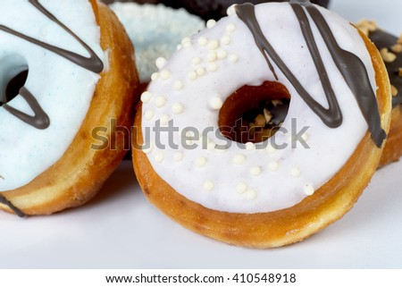 fresh donuts close-up with shallow depth of field on a white background - stock photo