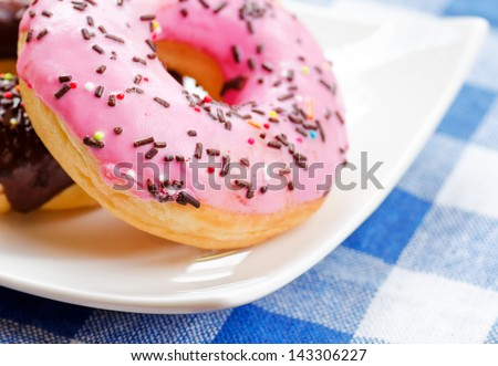 Fresh donuts on nature background.