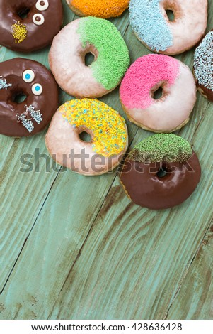 fresh donuts on wooden table top