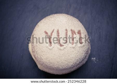 Fresh donuts. Shrove Tuesday. fat Thursday. homemade doughnuts with yum inscriptions - stock photo