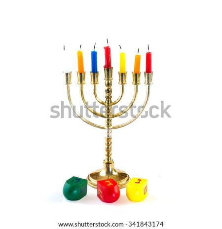 Fresh donuts with chocolate and wood dreidels  for Hanukkah celebration.  - stock photo