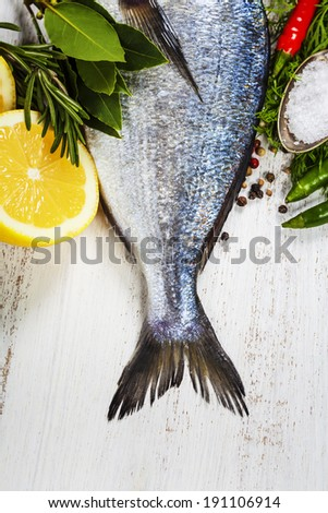 fresh dorado fish and vegetables on wooden board - food and drink - stock photo