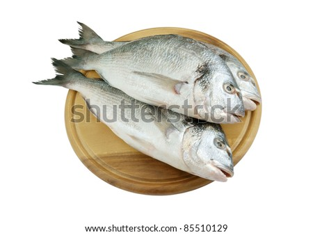 Fresh dorado fish on cutting board isolated on white