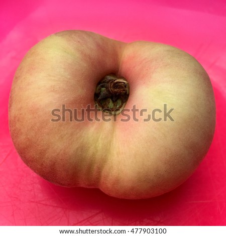Fresh doughnut peach fruit in closeup