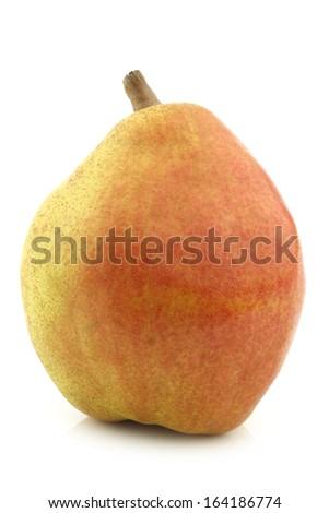 "fresh ""doyenne de comice"" pear on a white background - stock photo"