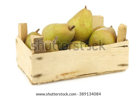 "fresh ""doyenne de comice"" pears in a wooden crate on a white background"