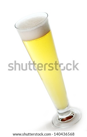 Fresh draft light beer in a glass isolated over white background - stock photo