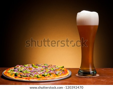 fresh draught beer and pizza with vegetables - stock photo