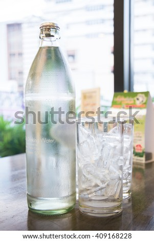 Fresh drinking water and ice in a glass. - stock photo