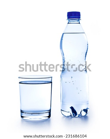 Fresh drinking water in plastic bottle and a glass of water - stock photo