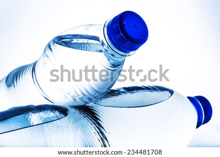 Fresh drinking water in plastic bottle on white background - stock photo