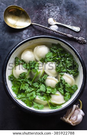 Fresh dumplings soup on plate. Top view - stock photo