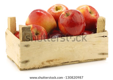 "fresh Dutch ""Jazz"" apples in a wooden crate on a white background"
