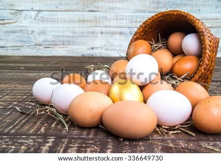 Fresh Egg duck eggs and golden eggs on wooden background. - stock photo