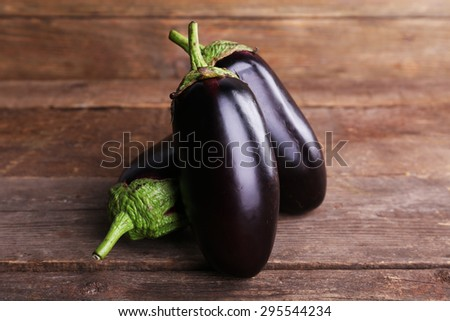 Fresh eggplant on wooden background - stock photo