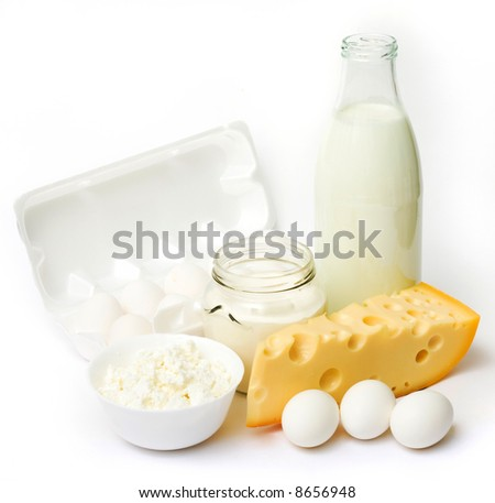 Fresh eggs and dairy products in glass containers - stock photo