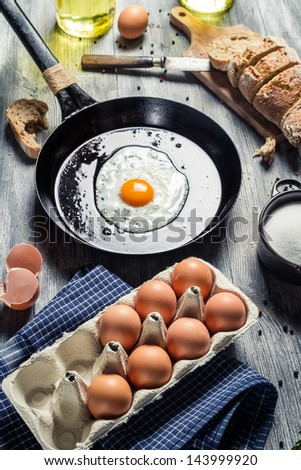 Fresh eggs for breakfast fried on a pan - stock photo