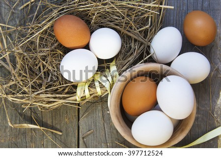 Fresh eggs from farm in the nest, old pottery. selective focus image