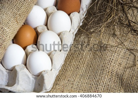 Fresh eggs from farm in the nest, old pottery. selective soft focus image