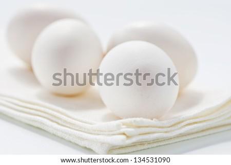 Fresh eggs on white background - stock photo