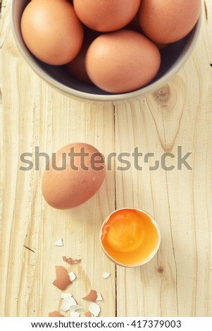 Fresh eggs on wood background. Top view