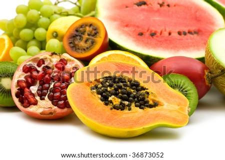 fresh exotic fruits on white background - stock photo