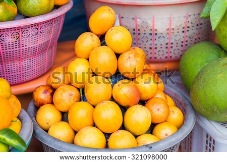 Fresh exotic tropical fruits for sale at an outdoor market. - stock photo