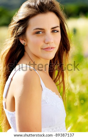 fresh face young woman portrait outdoors in the sunlight