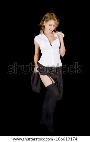 Fresh-faced young woman in her stocking feet after removing her boots. - stock photo
