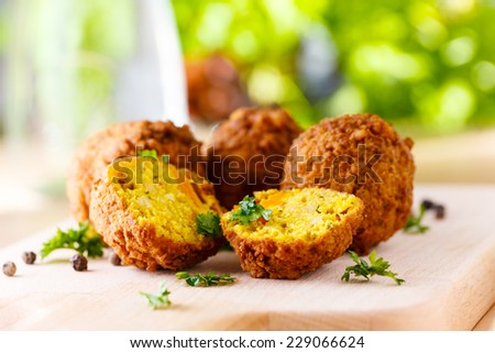 fresh falafel balls served on a wooden board - stock photo