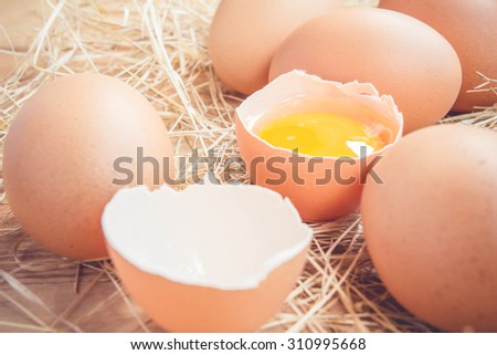 Fresh farm eggs on a wooden rustic background - stock photo