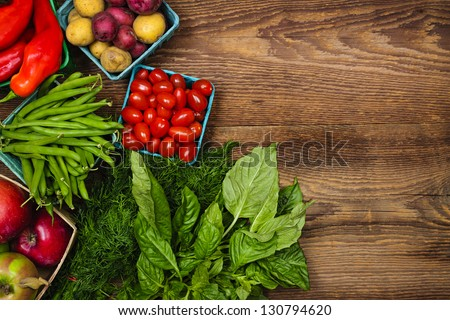 Fresh farmers market fruit and vegetable from above with copy space on brown wood - stock photo