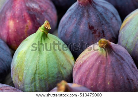 Fresh fig fruits on a wooden table