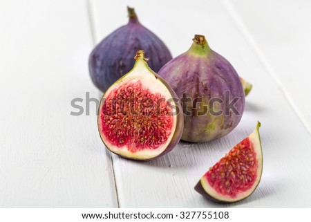 Fresh figs, cut and whole, whites to a substrate - stock photo