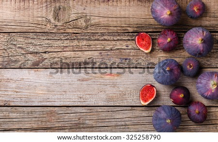 Fresh figs in different grade, vintage wooden Board.Copy space.selective focus - stock photo