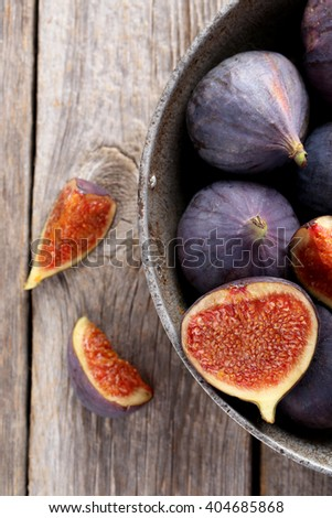 Fresh figs on a grey wooden table - stock photo