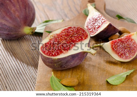 Fresh figs on a wooden background . Selective focus