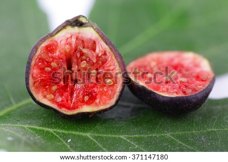 Fresh figs on green leaf  background