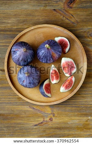 fresh figs top view on plate, food - stock photo