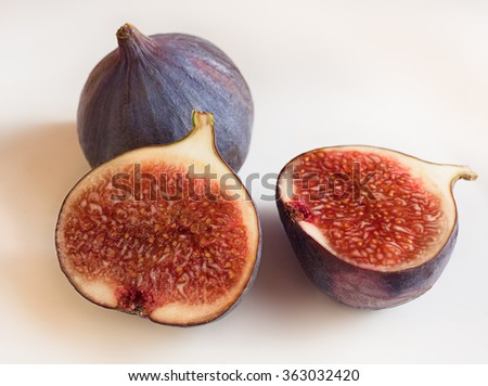 Fresh figs, whole and sliced on a white background - stock photo
