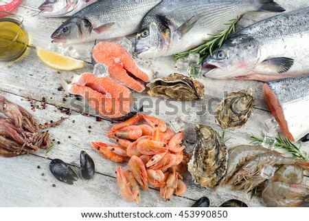 Fresh fish other seafood on wooden stock photo 470463683 for Aromatic herb for fish
