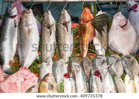 Fresh fish hanging on hooks at a fish market in Istanbul, Turkey - stock photo