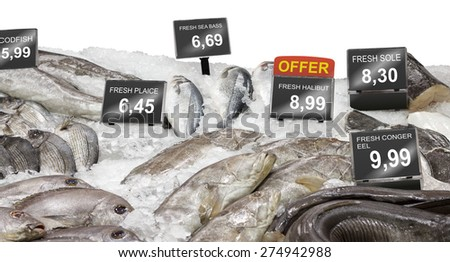 Fresh fish offer on market counter - stock photo