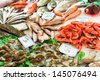 Fresh fish stall in the Boqueria market, Barcelona. - stock photo