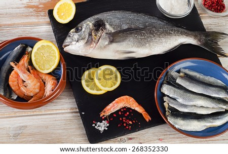 Fresh fish  with  spices , salt and shrimps - healthy food. Diet  concept. - stock photo