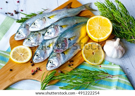 Fresh fish with the vegetables and lemon, bluefish