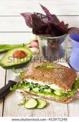 Fresh fitness sandwich with soft cheese and cucumber.