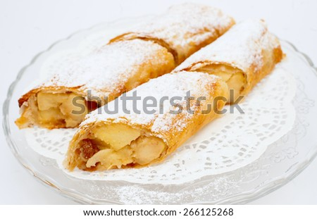 fresh flaky Swiss rolls - sweet filling of apples, bananas and strawberries - stock photo