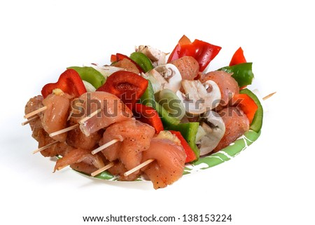 Fresh flesh meat shashlik with vegetables isolated on white - stock photo